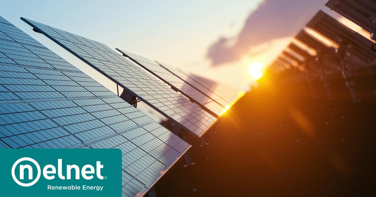 Nelnet Renewable Energy - The sun rises over solar panels in a community solar project