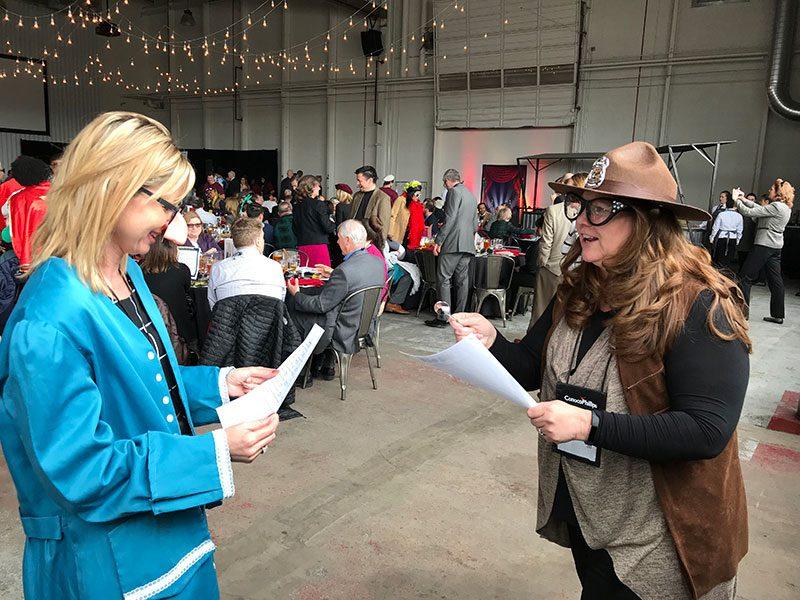 Nelnet Costumes Converstation associates attend charity luncheon