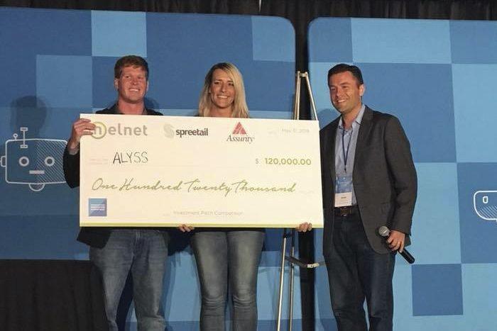 Alyss winning Nelnet Sponsored check for winning pitch competition