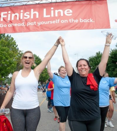 Participants celebrate a previous walk. This year's Virtual Heart Walk will focus on staying safe while social distancing.